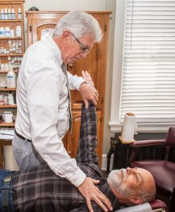 A male patient receives muscle testing